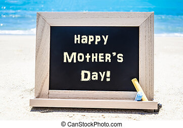 Happy Mother's day background on the sandy beach near the...