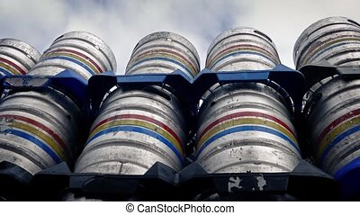 Moving Past Stacked Metal Barrels - Slowly moving past many...