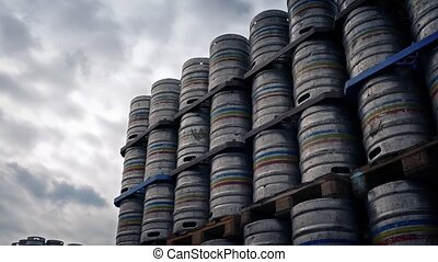 Pan Across Stacked Metal Barrels - Panning across large...