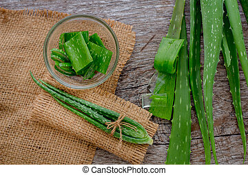 Aloevera fresh leaf on the wooden table,aloe vera on wooden table,Herbs for Health,copy space