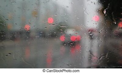 Rainy wipers and intersection. - View of intersection with...