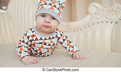 Baby lies on the bed and smiles - Cute Baby lies on the bed...
