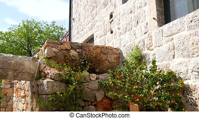 An old stone hotel. The hotel area close-up. - An old stone...