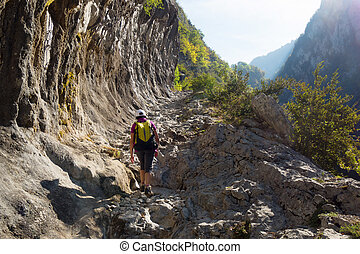 Woman hiking on the path of the Mature in the Pyrenees