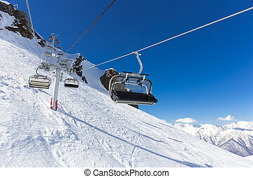 Scenery top view on winter mountains from ski resort Gorky...
