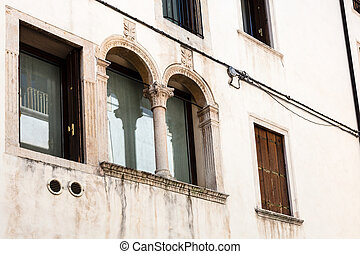wall of medieval palazzo in Vicenza - travel to Italy - wall...