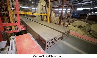 Robotic conveyor cutting and assembling bricks. - 02285...