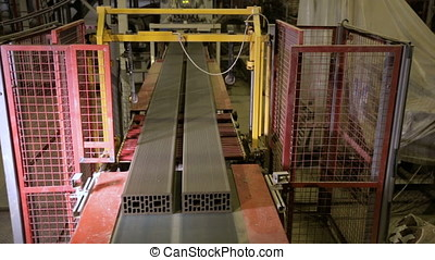 Conveyor Belt of a bricks production machine on a factory...