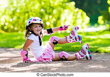 Little girl with roller skate shoes in a park - Little girl...