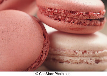 closeup shot of pastel colored macarons mix on wood table
