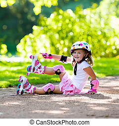 Little girl with roller skate shoes in a park