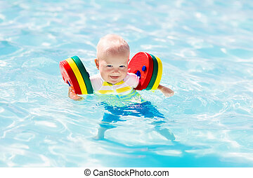 Little baby boy playing in swimming pool - Happy laughing...