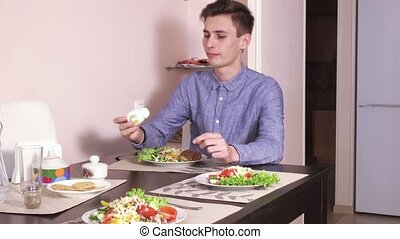 Man eating in a cafe - The cafe man eats a salad with tuna