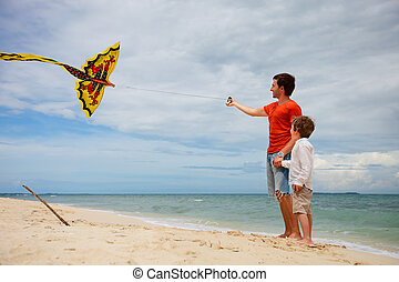 Dad and son flying kite - Happy dad and son flying kite...
