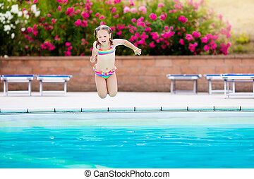 Child in swimming pool on summer vacation - Little girl...