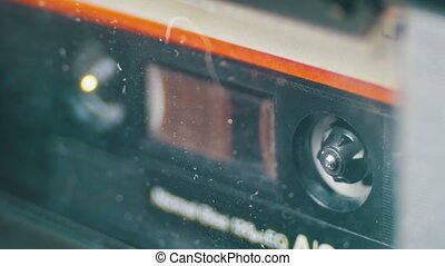 Audio Cassette in the Tape Recorder Rotates - Vintage Audio...