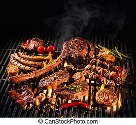 Assorted delicious grilled meat on a barbecue - Assorted...
