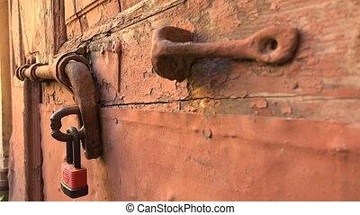Iron bolt on a wooden door. 4K. - Iron bolt on a wooden...