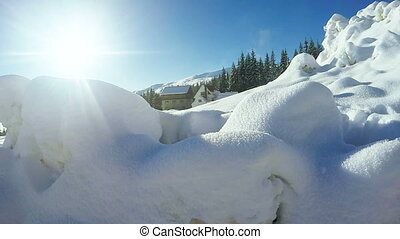 Snow snowdrifts in mountain village