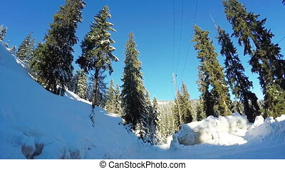 Winter road in mountains - High pile of snow on the edges of...
