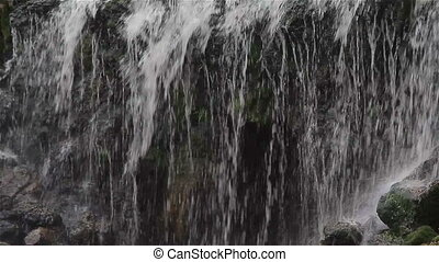 Water Falls on the Stones - Water is poured onto small...