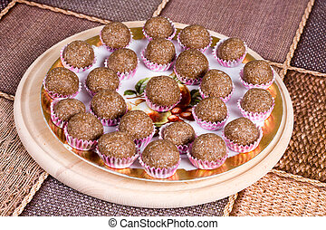 Chocolate balls with coconut in paper baskets
