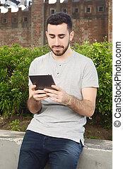 Man using digital tablet.