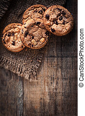 Chocolate cookies on dark napkin on wooden table with...