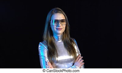 Cyber young woman in silver clothing wearing eyeglasses...