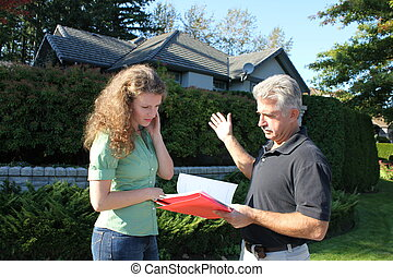 Buying a house - Young female with a realtor