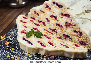 Cake with cream and cherries and cup of coffee,tasty cake...