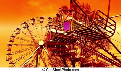 Fun at amazing park with fiery sky - Underside view of a...