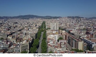 Barcelona city aerial descending shot, Spain. Famous Sagrada...