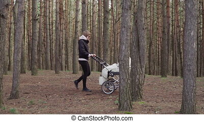 Young woman is walking with a baby