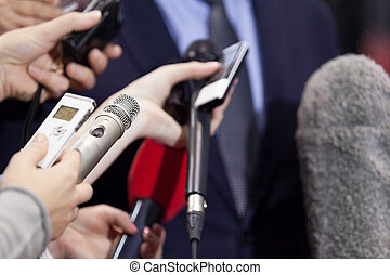 Press interview. News conference. - Journalists making media...