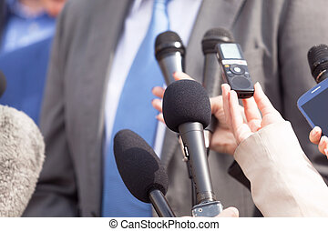 Journalists making media interview with businessperson or...
