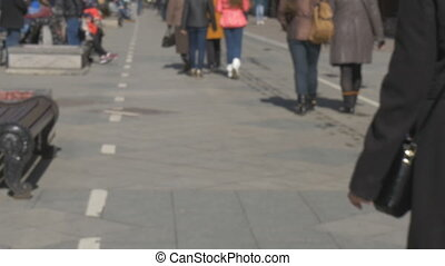Blurred intentionally, women with a child walk along the...