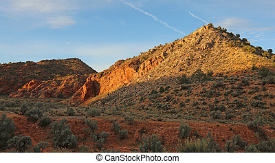 Desert Hills - The red dirt hills of the desert near...