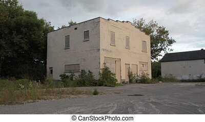 Abandoned business Wide - An abandoned building at the side...