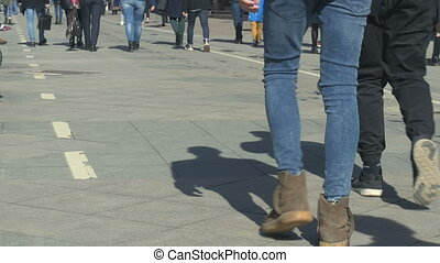 People walk down the street on a sunny day. Rhythm of life,...