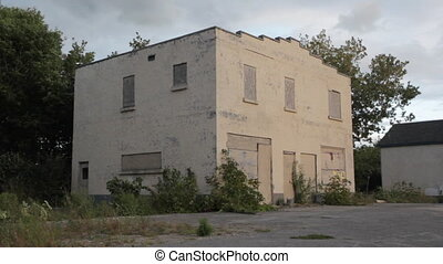 Abandoned business - An abandoned building at the side of...