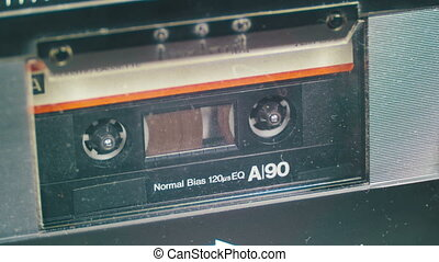 Vintage Audio Tape with White Blank Label is Rotates. Audio...