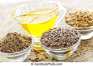 Flax seeds and linseed oil - Bowls of whole and ground flax...