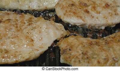 Very juicy and appetizing turkey fillet is prepared in a grill pan.
