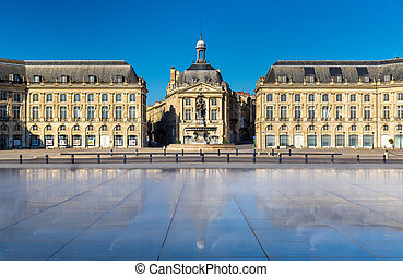 Famous water mirror fountain in front of Place de la Bourse...