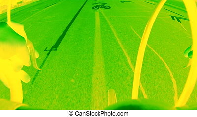 Neon green bicycle lane. - Riding a road bike on a bicycle...