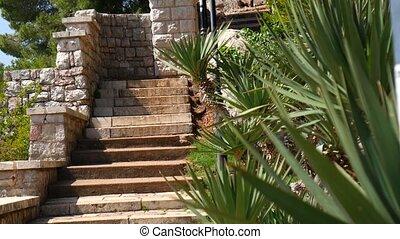 Stone stairs in Montenegro, in Park Milocer, Sveti Stefan. -...