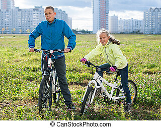 Children riding their bikes