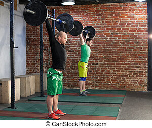 Two men are training at the gym