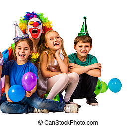 Birthday child clown playing with children. Kid holiday balloons celebratory.